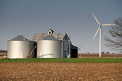26 April 2008:  Small farm buildings and a wind turbine coexist in the Twin Grove wind farm East of Bloomington Illinois