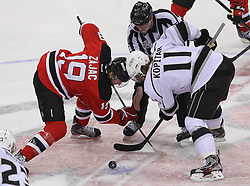 June 2; Newark, NJ, USA; New Jersey Devils center Travis Zajac (19) and Los Angeles Kings center Anze Kopitar (11) face-off during the first period of the 2012 Stanley Cup Finals Game 2 at the Prudential Center.
