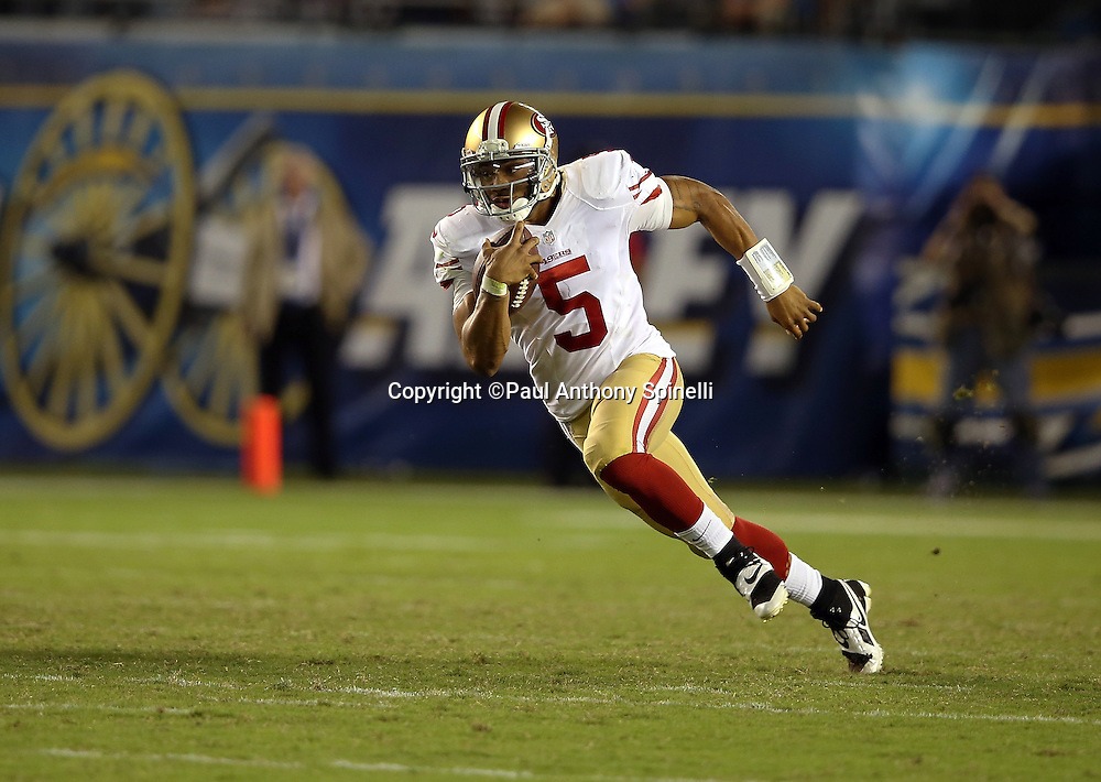 San Francisco 49ers quarterback B.J. Daniels (5) runs for a gain of 13 yards and a fourth quarter first down during the NFL week 4 preseason football game against the San Diego Chargers on Thursday, Aug. 29, 2013 in San Diego. The 49ers won the game 41-6. ©Paul Anthony Spinelli