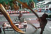 ECUADOR, HIGHLANDS, BANOS hot springs resort; pulling taffy candy