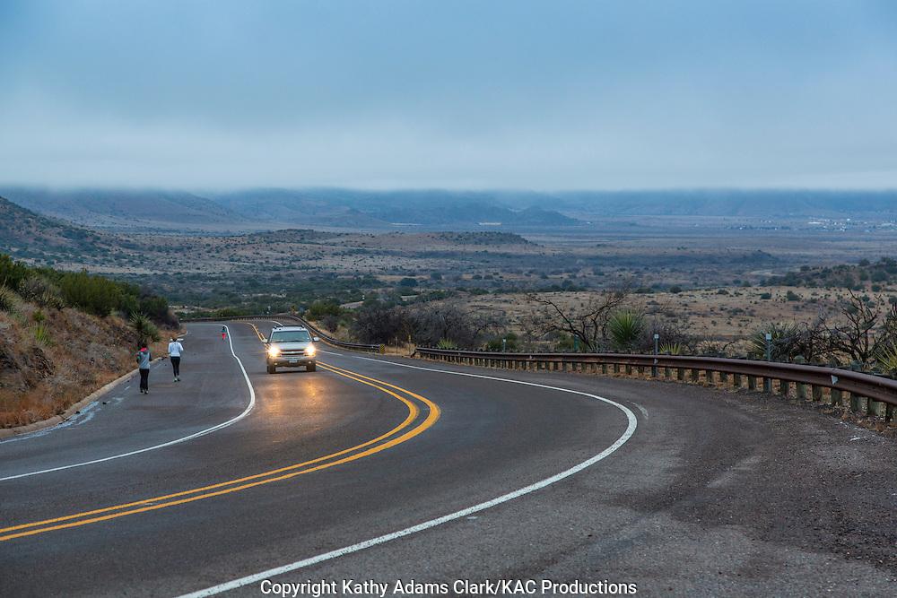 Morning joggers head north on Texas Highway 118 toward Alpine in west Texas.