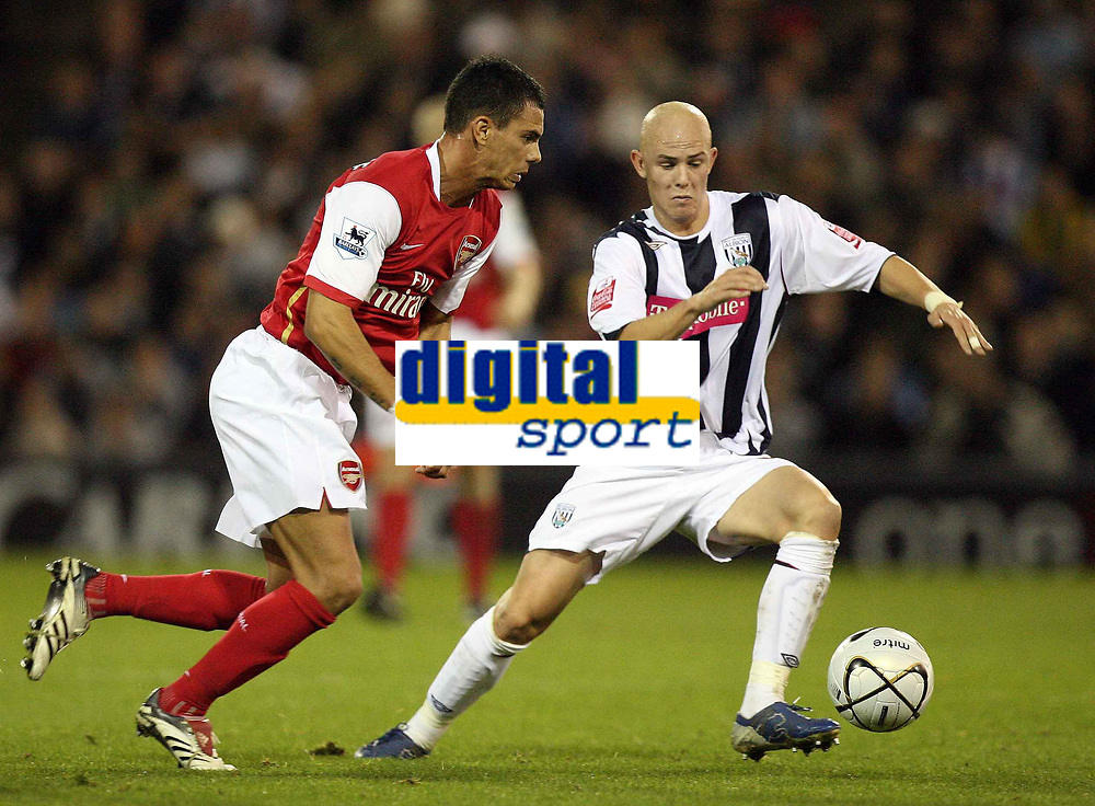 Photo: Rich Eaton.<br /> <br /> West Bromwich Albion v Arsenal. Carling Cup. 24/10/2006. Jeremie Aliadiere of Arsenal (rt) tries to get past Richard Chaplow of West Brom left