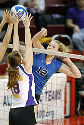 24 November 2006: Danielle Brazda gets half a block on this strike by Kristi Woodard during a Semi-final match between the Creighton University Bluejays and the Northern Iowa University Panthers. The Tournament was held at Redbird Arena on the campus of Illinois State University in Normal Illinois.<br />