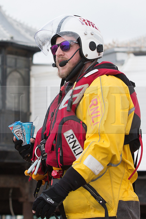 © Licensed to London News Pictures. 15/05/2016. Brighton, UK. A member of the Brighton RNLI collects ice creams for his colleagues who are patrolling the sea off Brighton. Photo credit: Hugo Michiels/LNP