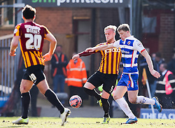 Reading's Pavel Pogrebnyak and Bradford City's Andrew Davies  - Photo mandatory by-line: Matt McNulty/JMP - Mobile: 07966 386802 - 07/03/2015 - SPORT - Football - Bradford - Valley Parade - Bradford City vReading - FA Cup - Quarter Final