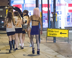 "© Licensed to London News Pictures . 22/10/2012 . Manchester , UK . A male student in a bra, skirt, stockings and heels . Students attend a Carnage UK pub crawl at bars in Manchester 's Deansgate Locks with a fancy dress theme of "" Pimps and Hoes "" . The event has been criticised for encouraging binge drinking , sexism and anti-social behaviour . Photo credit : Joel Goodman/LNP"