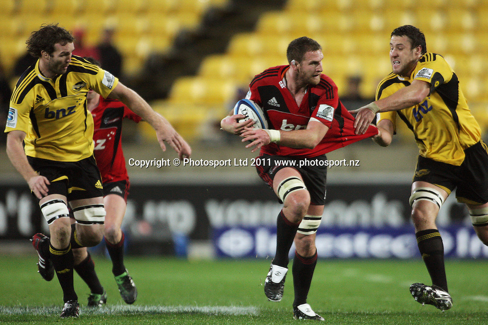Hurricanes locks Jason Eaton (left) and Jeremy Thrush close in on Kieran Read. Super 15 rugby match - Crusaders v Hurricanes at Westpac Stadium, Wellington, New Zealand on Saturday, 18 June 2011. Photo: Dave Lintott / photosport.co.nz