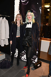 Left to right, SCARLETT CARLOS CLARKE and HARRIET VERNEY at the opening of the Tiger of Sweden Store, 210 Piccadilly, London on 3rd October 2013.
