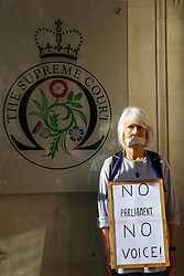 © Licensed to London News Pictures. 17/09/2019. London, UK. A protester with tape over her mouth demonstrate outside UK Supreme Court in London as the court begins a three day appeal hearing in the multiple legal challenges against the Prime Minister Boris Johnson's decision to prorogue Parliament ahead of a Queen's speech on 14 October. Eleven instead of the usual nine Supreme Court justices will hear the politically charged claim that Boris Johnson acted unlawfully in advising the Queen to suspend parliament for five weeks in order to stifle debate over the Brexit crisis.It is the first time the Supreme Court has been summoned for an emergency hearing outside legal term time.Lady Hale, the first female president of the court who retires next January, will preside. Photo credit: Dinendra Haria/LNP
