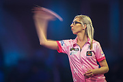 Fallon Sherrock (England) throwing against Mensur Suljovic (Serbia) (not in picture) in the Second Round of the PDC William Hill World Darts Championship at Alexandra Palace, London, United Kingdom on 21 December 2019.