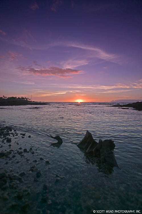 Sunset on horizon of still water at Kohala, Big Island, Hawaii