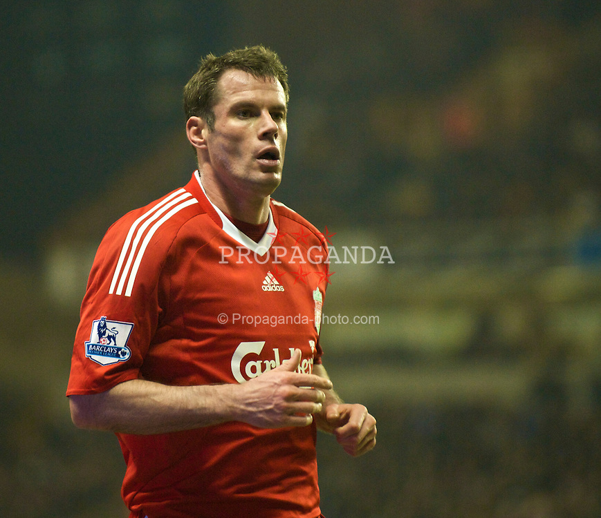 WOLVERHAMPTON, ENGLAND - Tuesday, January 26, 2010: Liverpool's Jamie Carragher in action against Wolverhampton Wanderers during the Premiership match at Molineux. (Photo by David Rawcliffe/Propaganda)