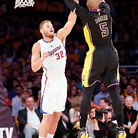 31 October 2014: Los Angeles Lakers forward Carlos Boozer (5) takes a jump shot over Los Angeles Clippers forward Blake Griffin (32) during the Los Angeles Clippers 118-111 victory over the Los Angeles Lakers, at the Staples Center, Los Angeles, California, USA.