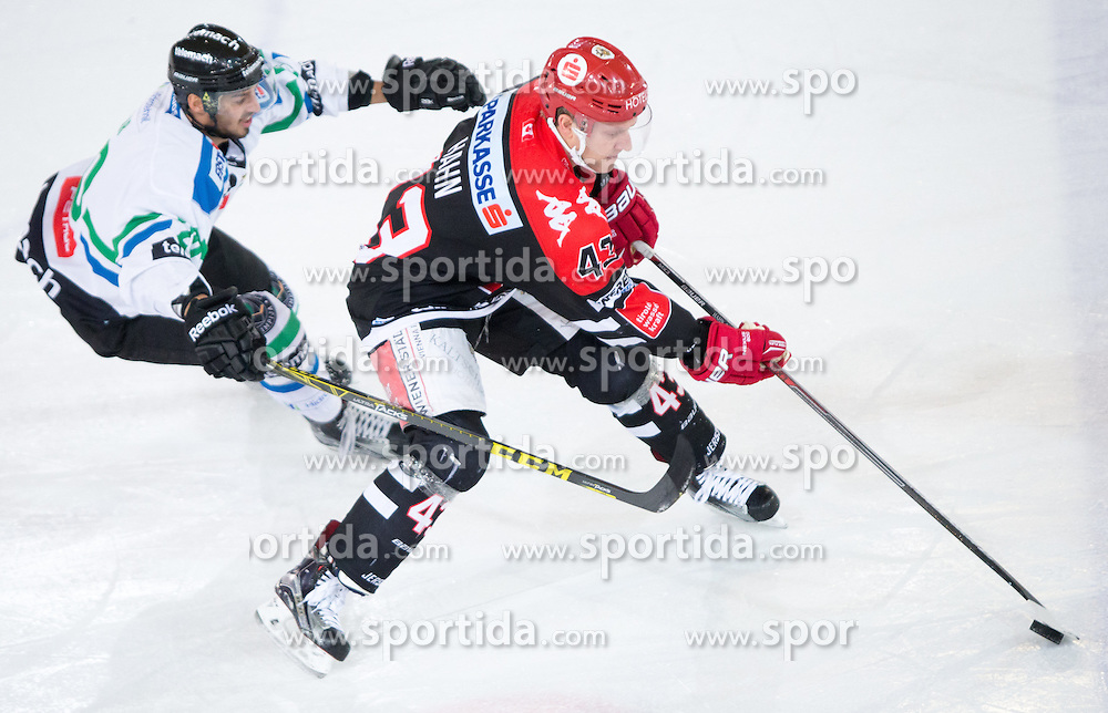 28.12.2015, Tiroler Wasserkraft Arena, Innsbruck, AUT, EBEL, HC TWK Innsbruck die Haie vs HDD TELEMACH Olimpija Ljubljana, 36. Runde, im Bild vl.: David Planko (HDD Telemach Olimpija Ljubljana), Derek Hahn (HC TWK Innsbruck Die Haie) // during the Erste Bank Icehockey League 36th round match between HC TWK Innsbruck  die Haie and HDD TELEMACH Olimpija Ljubljana at the Tiroler Wasserkraft Arena in Innsbruck, Austria on 2015/12/28. EXPA Pictures © 2015, PhotoCredit: EXPA/ Jakob Gruber