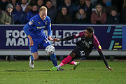 AFC Wimbledon midfielder Mitchell (Mitch) Pinnock (11) battles for possession with Peterborough United midfielder Reece Brown (12) during the EFL Sky Bet League 1 match between AFC Wimbledon and Peterborough United at the Cherry Red Records Stadium, Kingston, England on 18 January 2020.