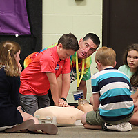 """Lee Stratton keeps a close eye on how Denton Russell, 12, pereforms CPR on a dummy as part of """"safe sitter"""" class this week."""