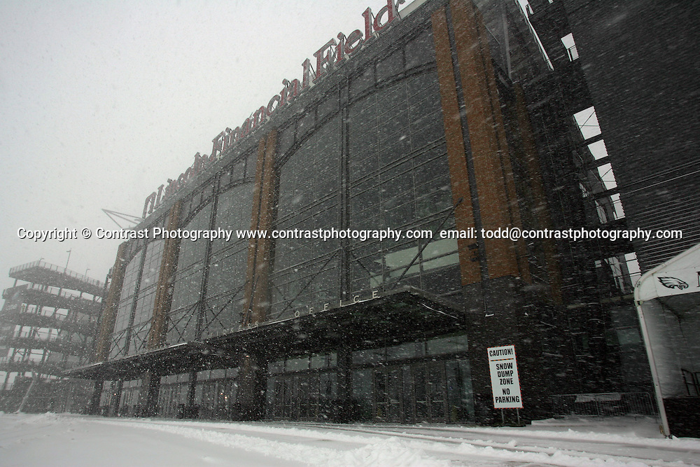 22 Jan 2005:Fans of the Philadelphia Eagles during a snow storm the Saturday before the Philadelphia Eagles vs Atlanta Falcons at Lincoln Financial Field in Philadelphia, PA. <br /> <br /> Mandatory Credit:Todd Bauders/ContrastPhotography.com