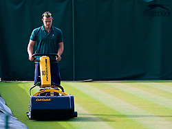 LONDON, ENGLAND - Monday, July 9, 2018: The Ground staff mow the grass as they prepare the courts on day seven of the Wimbledon Lawn Tennis Championships at the All England Lawn Tennis and Croquet Club. (Pic by Kirsten Holst/Propaganda)