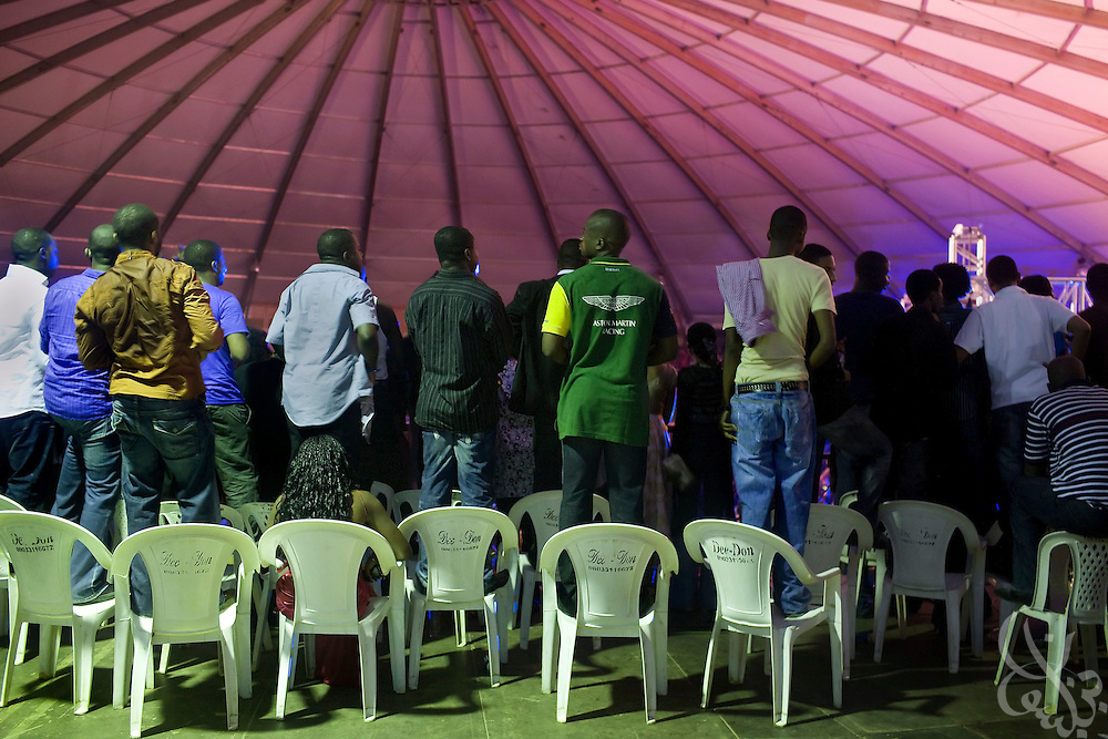 Nigerian fans watch from atop chairs in the newly constructed Dome concert hall during the 3rd Annual THISDAY music and fashion festival July 11, 2008 in Abuja, Nigeria. Pop stars Jay-Z , Rihanna and Usher participated in the Abuja leg of the event, an annual festival designed to raise awareness of African issues while promoting positive images of Africa using music, fashion and culture in a series of concerts and events in Nigeria, the United States and the United Kingdom. .
