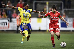 April 28, 2018 - Sint-Truiden, BELGIUM - STVV's Jordan Botaka and Oostende's Aleksandar Bjelica fight for the ball during a soccer game between Sint-Truidense V.V. and KV Oostende, in Sint-Truiden, Saturday 28 April 2018, on day six of the Play-Off 2B of the Belgian soccer championship...BELGA PHOTO YORICK JANSENS (Credit Image: © Yorick Jansens/Belga via ZUMA Press)