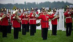 © Licensed to London News Pictures. 10/07/2012..Harrogate, England...The band plays as soldiers from the 1st Battalion The Yorkshire Regiment exercise the Freedom of Harrogate with a march past at the Great Yorkshire Show after recently returning from Afghanistan...England's premier agricultural show opened it's gates today for the start of three days of showcasing the best in British farming and the countryside...The event, which attracts over 130,000 visitors each year is the 154th show and displays the cream of the country's livestock and offers numerous displays and events and gives the chance to see many different countryside activities...Photo credit : Ian Forsyth/LNP