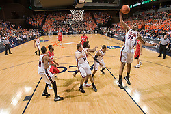 Virginia forward Mike Scott (32) grabs a rebound against Maryland.  The Virginia Cavaliers defeated the Maryland Terrapins 91-76 at the University of Virginia's John Paul Jones Arena  in Charlottesville, VA on March 9, 2008.