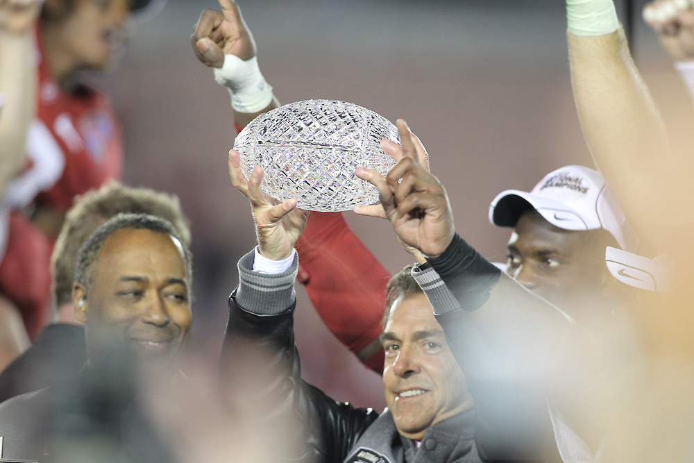 PASADENA,CA - JANUARY 07: Head coach Nick Saban of the Alabama Crimson Tide celebrates with the trophy after the game against the Texas Longhorns. The Crimson Tide defeated the Longhorns 37-21 in the Citi BCS National Championship game on January 7, 2010 at the Rose Bowl in Pasadena, CA.  Photo by Tom Hauck. PLAYER:Nick Saban