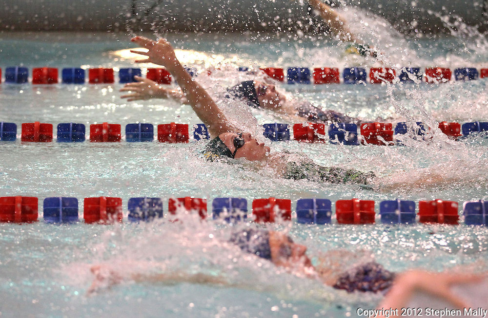 Kennedy's Henna McCoy swims the backstroke section for her team in the 200 yard Medley Relay event during the Kennedy at Washington meet at Washington High School in Cedar Rapids on Tuesday evening, October 2, 2012. McCoy's team won the event with a time of 1:59.13.