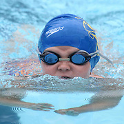 Swimmer Lucy Kornacki (7) competes in the 25 meter breaststroke during the Summer Swim league championships finials Saturday, July. 17, 2015 at Western YMCA in Wilmington, DEL