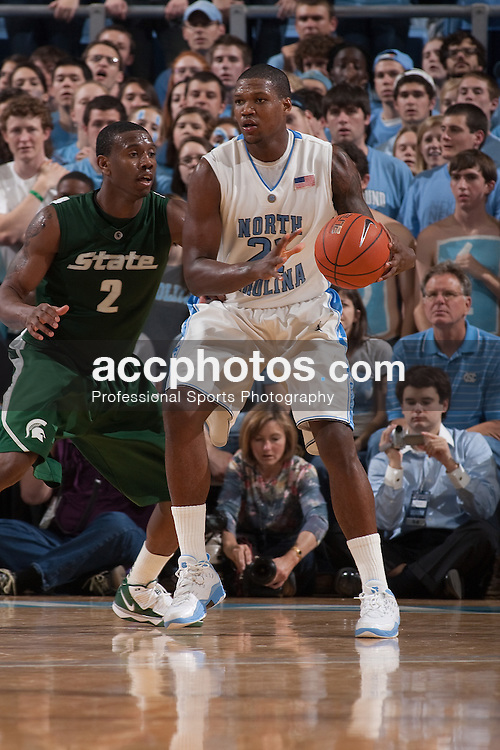01 December 2009: North Carolina Tar Heels forward Deon Thompson (21) is pressured by Michigan State Spartans forward Raymar Morgan (2) in a North Carolina 82-89 win over the Michigan State at the Dean Smith Center in Chapel Hill, NC.