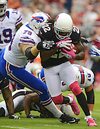 Oct. 14, 2012; Glendale, AZ, USA;  Arizona Cardinals cornerback William Gay (22) is tackled by Buffalo Bills offensive tackle Erik Pears (79) after intercepting the ball in the first half at University of Phoenix Stadium. Mandatory Credit: Jennifer Stewart-US PRESSWIRE..