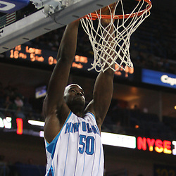 Feb 01, 2010; New Orleans, LA, USA; New Orleans Hornets center Emeka Okafor (50) dunks against the Phoenix Suns during the second half at the New Orleans Arena. Mandatory Credit: Derick E. Hingle-US PRESSWIRE