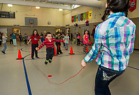 Kat and Shifra swing the jumprope as Vercin jumps into the middle during Elm Street School's Jump Rope for Heart event Friday afternoon raising money for the American Heart Association.  (Karen Bobotas/for the Laconia Daily Sun)