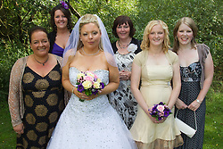 Visually impaired bride with female family and friends.