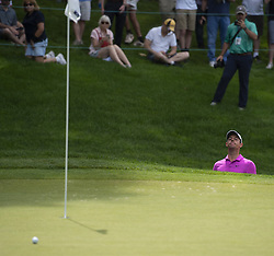 June 22, 2018 - Cromwell, CT, USA - Rory McIlroy peeks up to look at his short after blasting out of a bunker on the 18th hole during the second round of the Travelers Championship at TPC River Highlands in Cromwell, Conn., on Friday, June 22, 2018. (Credit Image: © Patrick Raycraft/TNS via ZUMA Wire)