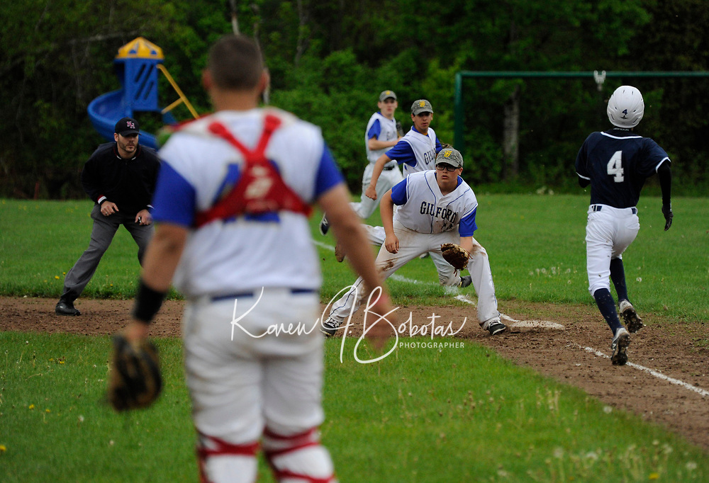 Gilford varsity baseball with White Mountain.  Karen Bobotas for the Laconia Daily Sun