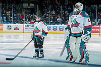 KELOWNA, CANADA - DECEMBER 27: Dominic Ashbee stands on the blue line as the Pepsi Player of the game alongside James Porter #1 of the Kelowna Rockets against the Kamloops Blazers on December 27, 2017 at Prospera Place in Kelowna, British Columbia, Canada.  (Photo by Marissa Baecker/Shoot the Breeze)  *** Local Caption ***