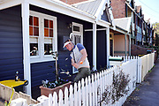 A golfer plays from the front yard of a house on World Urban Golf Day in Newcastle, Australia. Played with soft balls and without keeping score, Urban Golf is an attempt to take the game of golf away from the manicured lawns and into the urban environment.