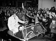 Ronnie Delaney Welcomed Home from Melbourne at Mansion House.19/12/1956..Ronald Michael Delany (06/03/1935), better known as Ron or Ronnie is a former Irish athlete, who specialised in middle distance running..Born in Arklow, Delany moved with his family to Dublin when he was 6. His father had got a job in Jacobs Biscuit Factory and there Delany went to Catholic University School..Delany studied in the United States at Villanova University, where he was coached by the well-known track coach Jumbo Elliott. His first achievement of note was reaching the final of the 800m at the 1954 European Championships in Bern..In 1956, he became the seventh runner to join the club of Four-minute milers, but nonetheless struggled to make the Irish team for the 1956 Summer Olympics held in Melbourne..Delany qualified for the Olympic 1500 m final, in which home runner John Landy was the big favourite. Delany kept close to Landy until the final lap, when he started a crushing final sprint, winning the race in a new Olympic Record.[3] Delany thereby became the first Irishman to win an Olympic title in athletics since Bob Tisdall in 1932..Delany won the Bronze medal at the 1958 European Championships at 1500m.Delany went on to represent Ireland once again at the 1960 Summer Olympics held in Rome, this time in the 800 metres. He finished 6th in his quarter-final..He remained the last Olympics champion of Ireland for 36 years, until Michael Carruth won the gold medal in boxing at the 1992 Olympics in Barcelona..Delany continued his running career in North America, winning four successive AAU titles in the mile, adding to his total of four Irish national titles, and three NCAA titles. He was next to unbeatable on indoor tracks over that period, which included a 40-race winning streak. He broke the World Indoor Mile Record on three occasions..He was granted the Freedom of Dublin City in 2006.Was also conferred with an honorary Doctor of Laws Degree by University College Dublin in 2006. Now