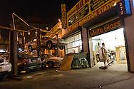 New York. Chelsea street life on 11th avenue, parking lot at night  Manhattan   /  scene de rue a Chelsea parking  New York - Etats-unis