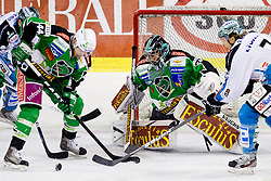 Jamie Fraser (HDD Tilia Olimpija, #44) clears a puck in front of Matija Pintaric (HDD Tilia Olimpija, #69) during ice-hockey match between HDD Tilia Olimpija and EHC Liwest Black Wings Linz at second match in Semifinal  of EBEL league, on March 8, 2012 at Hala Tivoli, Ljubljana, Slovenia. (Photo By Matic Klansek Velej / Sportida)