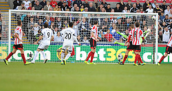 Swansea City's Jonathan de Guzman sends the ball in the top right hand corner to score a goal. - Photo mandatory by-line: Alex James/JMP - Tel: Mobile: 07966 386802 19/10/2013 - SPORT - FOOTBALL - Liberty Stadium - Swansea - Swansea City v Sunderland - Barclays Premier League