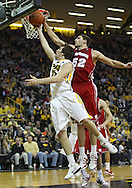 February 09 2011: Iowa Hawkeyes forward Zach McCabe (15) puts up a shot as Wisconsin Badgers forward Keaton Nankivil (52) defends during the second half of an NCAA college basketball game at Carver-Hawkeye Arena in Iowa City, Iowa on February 9, 2011. Wisconsin defeated Iowa 62-59.