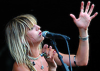 Juliet Simms, lead vocalist and guitarist for the band Automatic Loveletter entertains the crowd at the Vans Warped Tour stop in Atlanta, Ga