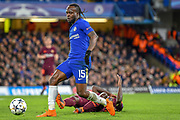 Chelsea midfielder Victor Moses (15) and Barcelona defender Samuel Umtiti  (23) claims a foul during the Champions League match between Chelsea and Barcelona at Stamford Bridge, London, England on 20 February 2018. Picture by Martin Cole.