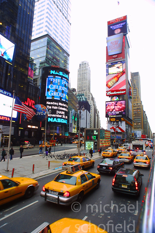 Yellow taxi cabs on Times Square, New York City, as seen from the top of a tourist bus, in November 2001..Images of the city of New York, United States of America, taken between 20th-22nd November, 2001..©Michael Schofield.