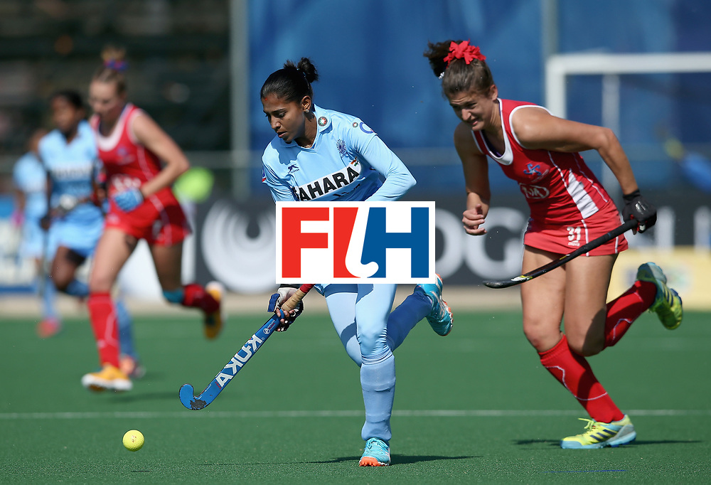 JOHANNESBURG, SOUTH AFRICA - JULY 12: Anupa Barla of India and Fernanda Villagran of Chile battle for possession during day 3 of the FIH Hockey World League Semi Finals Pool B match between India and Chile at Wits University on July 12, 2017 in Johannesburg, South Africa. (Photo by Jan Kruger/Getty Images for FIH)