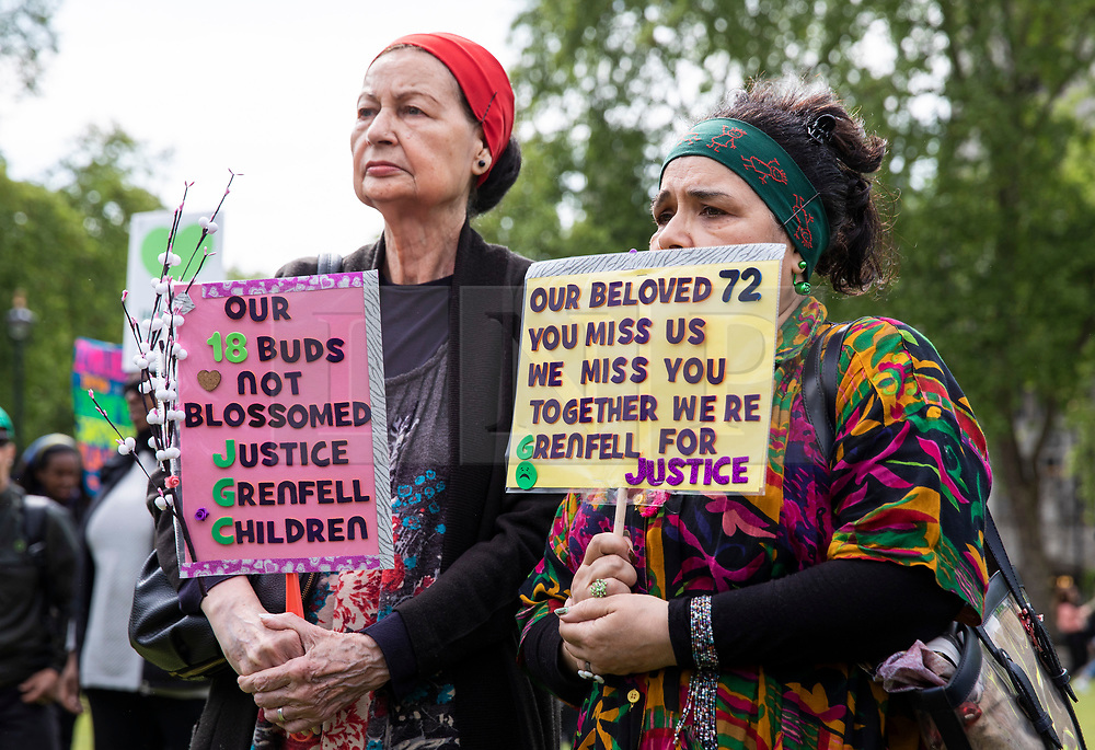 © Licensed to London News Pictures. 14/05/2018. London, UK. Two women at a protest in Parliament Square to mark eleven months since the Grenfell Tower Fire in which 71 people were killed. Photo credit: Rob Pinney/LNP