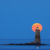 Whaleback Lighthouse with buck full moon in southern Maine near the New Hampshire border. This historic New England lighthouse is located near Portsmouth, NH and is also known as Whaleback Light or Whaleback Ledge Lighthouse. A rising full moon always attracts a lot of nature lovers and photographers alike and there was no difference last night. Originally, I was inspired by the tall and old lighthouse structure out in the ocean that tells the story of bracing Mother Nature for a century and more. After setting up tripod and camera I patiently waited for the moonrise and when it finally arrived I photographed away to ensure I captured my vision of this unforgettable natural phenomenal.   <br /> <br /> Historic New England and Whaleback Lighthouse photos are available as museum quality photography prints, canvas prints, acrylic prints, wood prints or metal prints. Fine art prints may be framed and matted to the individual liking and decorating needs:<br /> <br /> https://juergen-roth.pixels.com/featured/whaleback-lighthouse-with-buck-full-moon-juergen-roth.html<br /> <br /> Good light and happy photo making!<br /> <br /> My best,<br /> <br /> Juergen<br /> Prints: http://www.rothgalleries.com<br /> Photo Blog: http://whereintheworldisjuergen.blogspot.com<br /> Instagram: https://www.instagram.com/rothgalleries<br /> Twitter: https://twitter.com/naturefineart<br /> Facebook: https://www.facebook.com/naturefineart