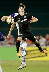 September 9, 2017 - Washington, DC, USA - 20170909 - Orlando City FC midfielder DILLON POWERS (15), back, and D.C. United midfielder RUSSELL CANOUSE (4) make a play for a head ball in the second half at RFK Stadium in Washington. (Credit Image: © Chuck Myers via ZUMA Wire)
